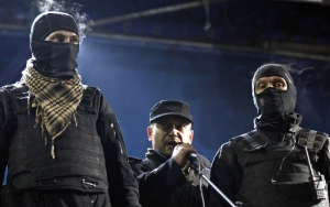 "Dmytro Yarosh, leader of the far-right paramilitary organization Right Sector, flanked by two members of the group.  Right Sector has actively participated in the controversial ""anti-terrorist operation"" in the Donbas in which hundreds of civilians have died.  (Reuters / David Mdzinarishvili)"