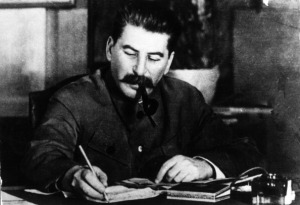 Joseph Stalin smoking his pipe at his desk. (Getty)